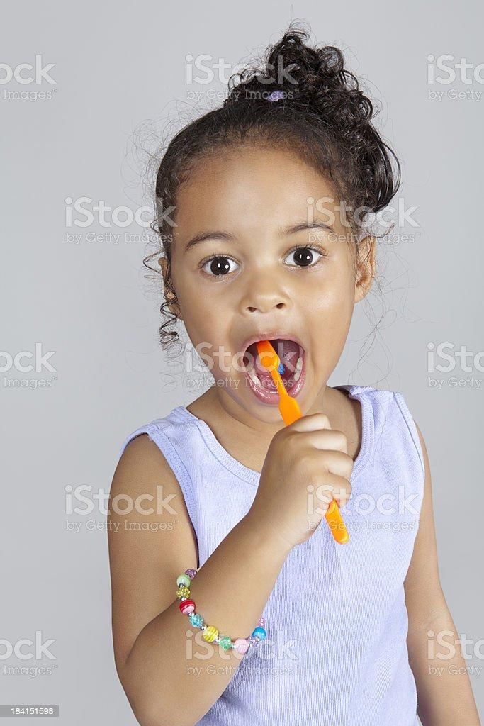 Young girl brushing teeth stock photo