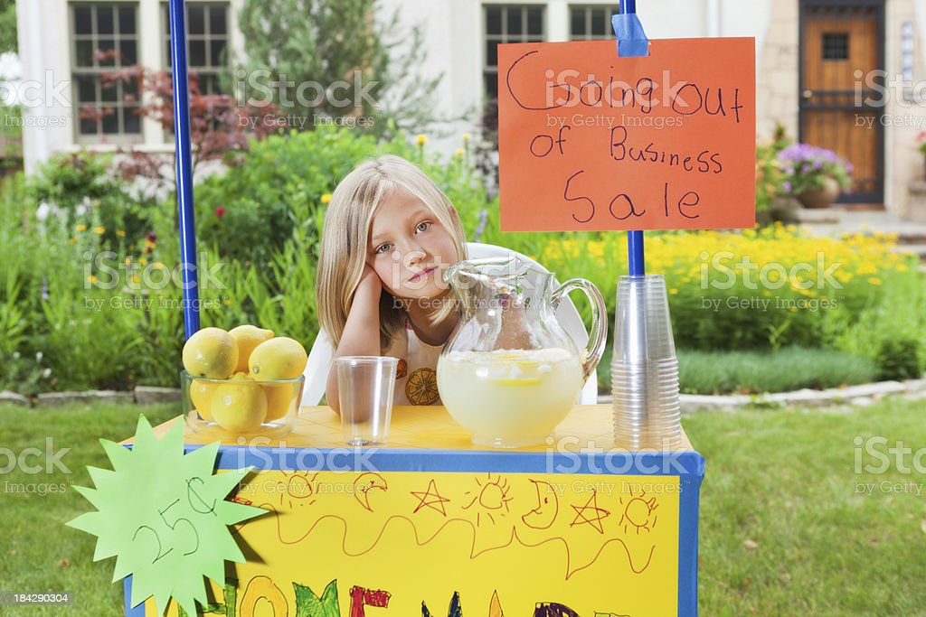 Young Girl Business Entrepreneur with Recession Failing Lemonade Stand Hz royalty-free stock photo