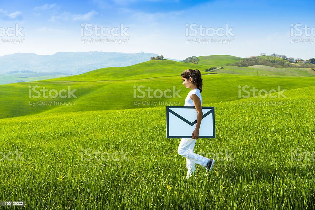 Young girl carrying envelope: e-mail concept royalty-free stock photo