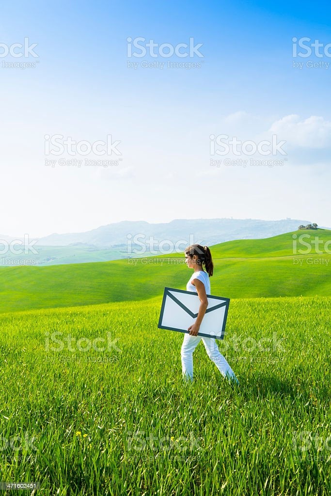 Young girl carrying envelope: e-mail concept stock photo