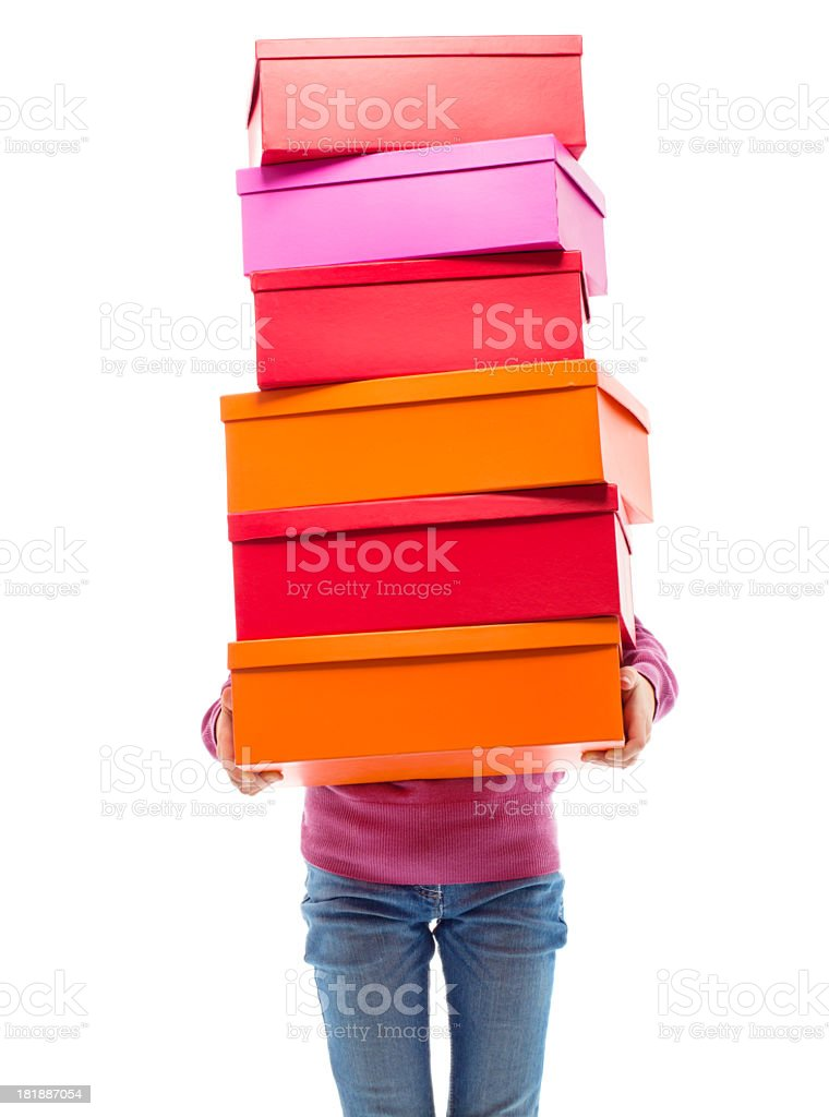 Young girl carrying shopping boxes stock photo