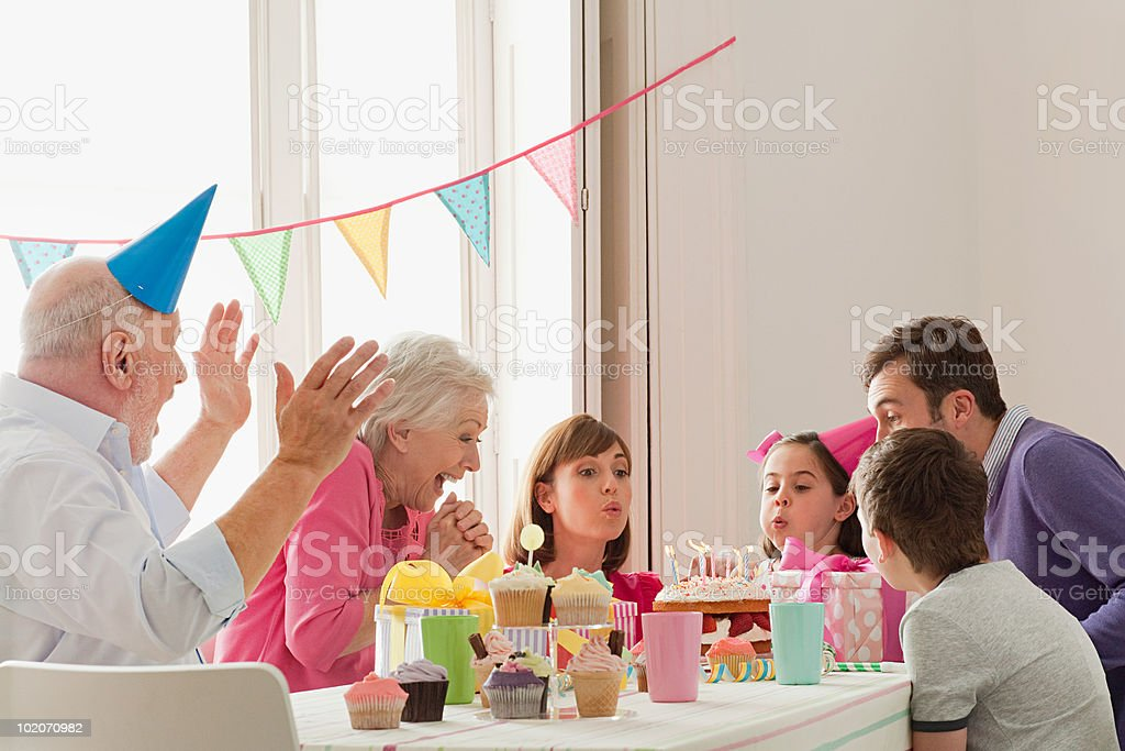 Young girl celebrating birthday with family royalty-free stock photo