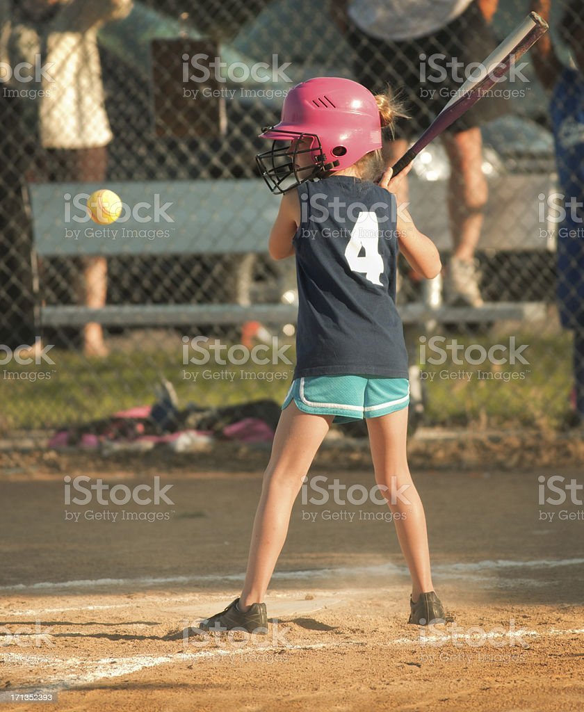 Young Girl Child Softball Player Batting in Competitive Game royalty-free stock photo