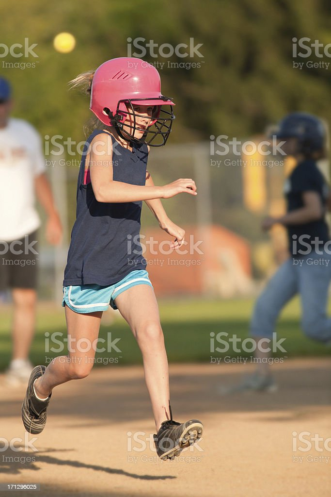 Young Girl Child Softball Player Running to Base in Game royalty-free stock photo
