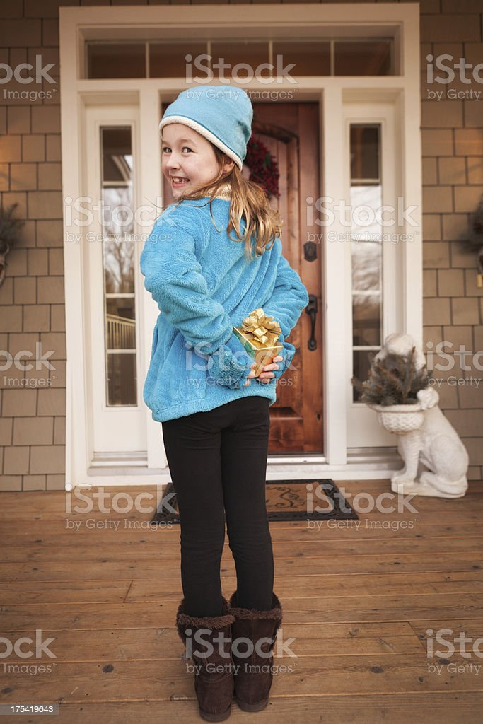 Young Girl Child Visitor with Christmas Bearing Surprise Gift royalty-free stock photo