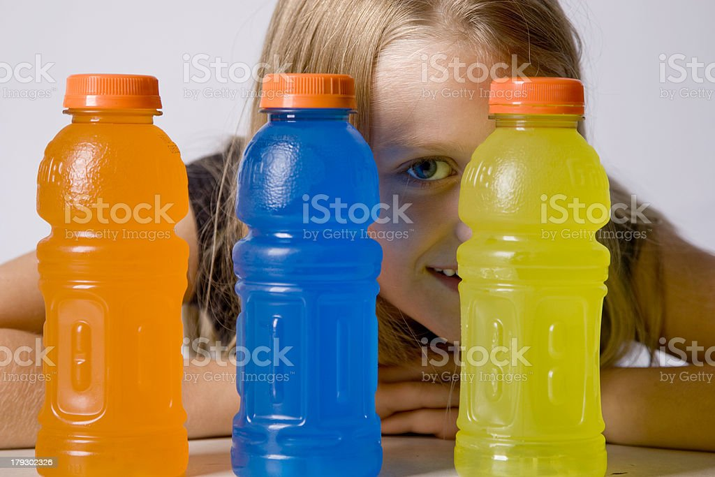 Young Girl Chooses Sports Drink stock photo