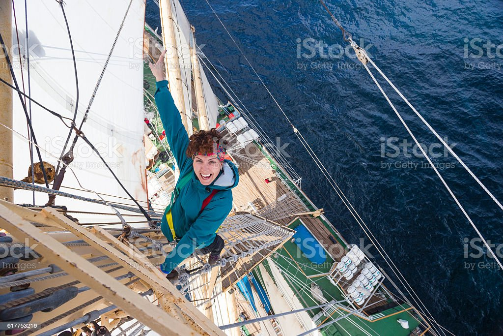 Young girl climbs the mast frigate stock photo
