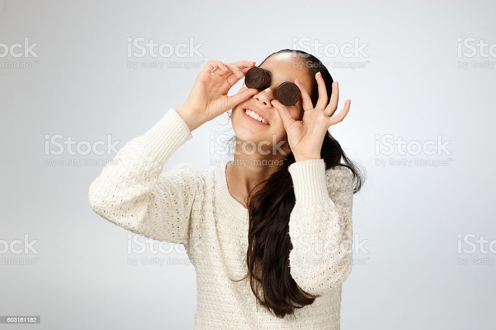 Young girl closing her eyes with cocoa biscottis stock photo