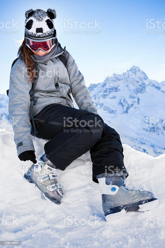 Young girl closing skiing boots stock photo