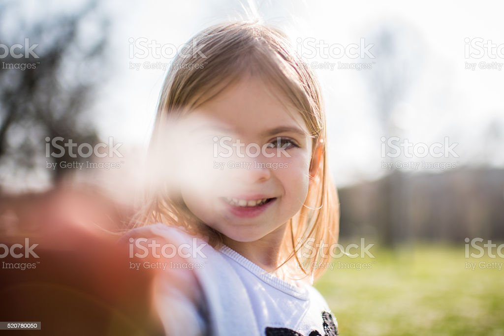 Young girl collecting flowers stock photo