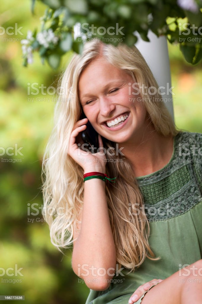 young girl communicates with mobile cell phone royalty-free stock photo