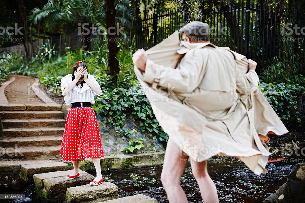 Young girl, confronted by flasher, covers her eyes, horrified royalty-free stock photo