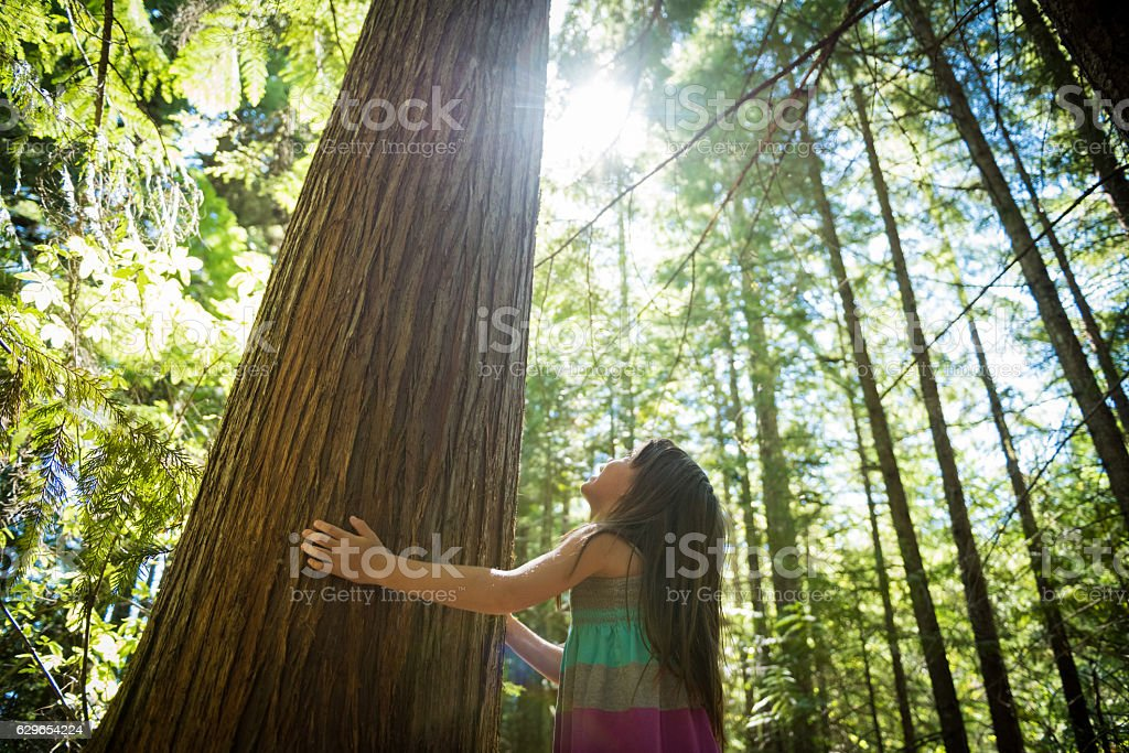 Young girl connecting with nature stock photo