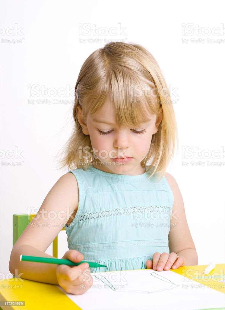 Young girl contemplating her drawing stock photo