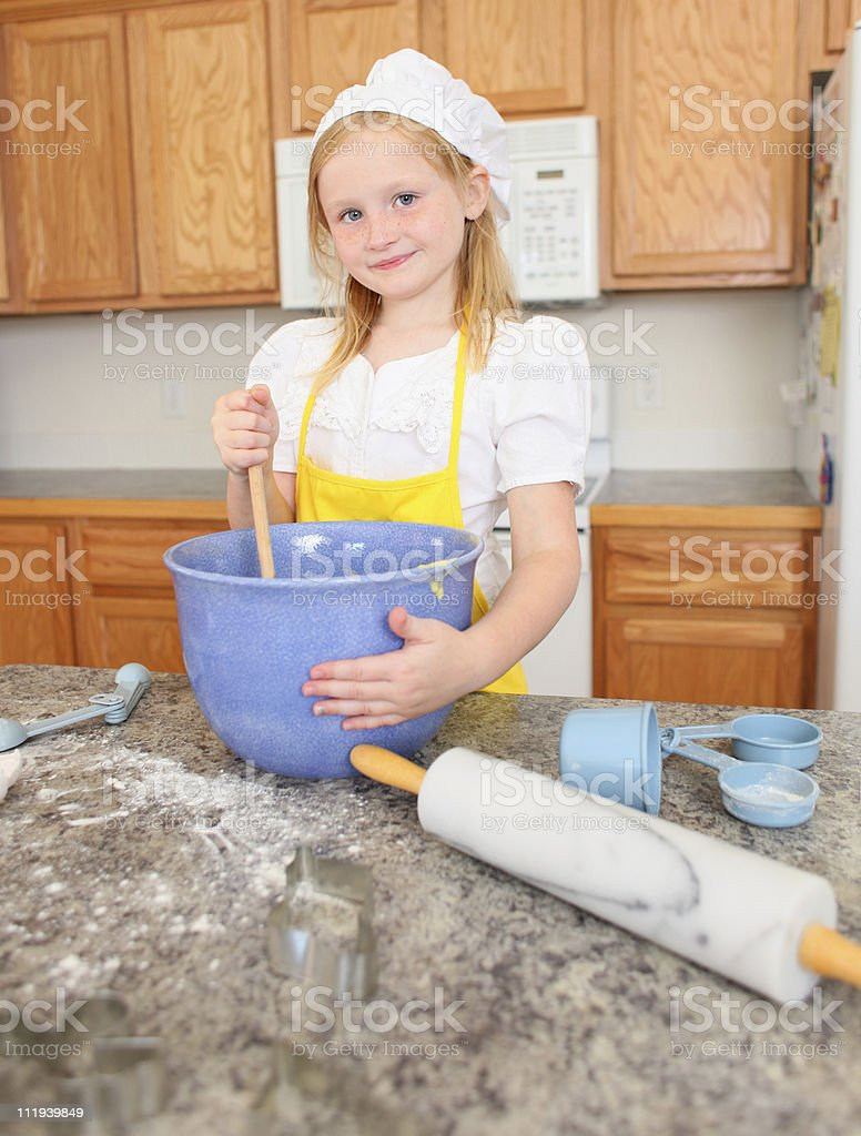 young girl cooking stock photo