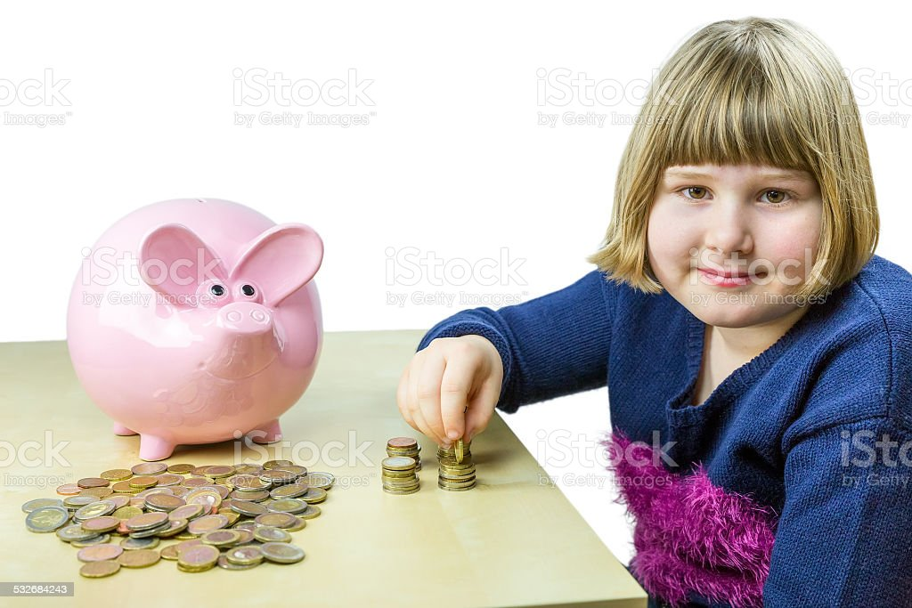 Young girl counting euro coins from piggy bank stock photo