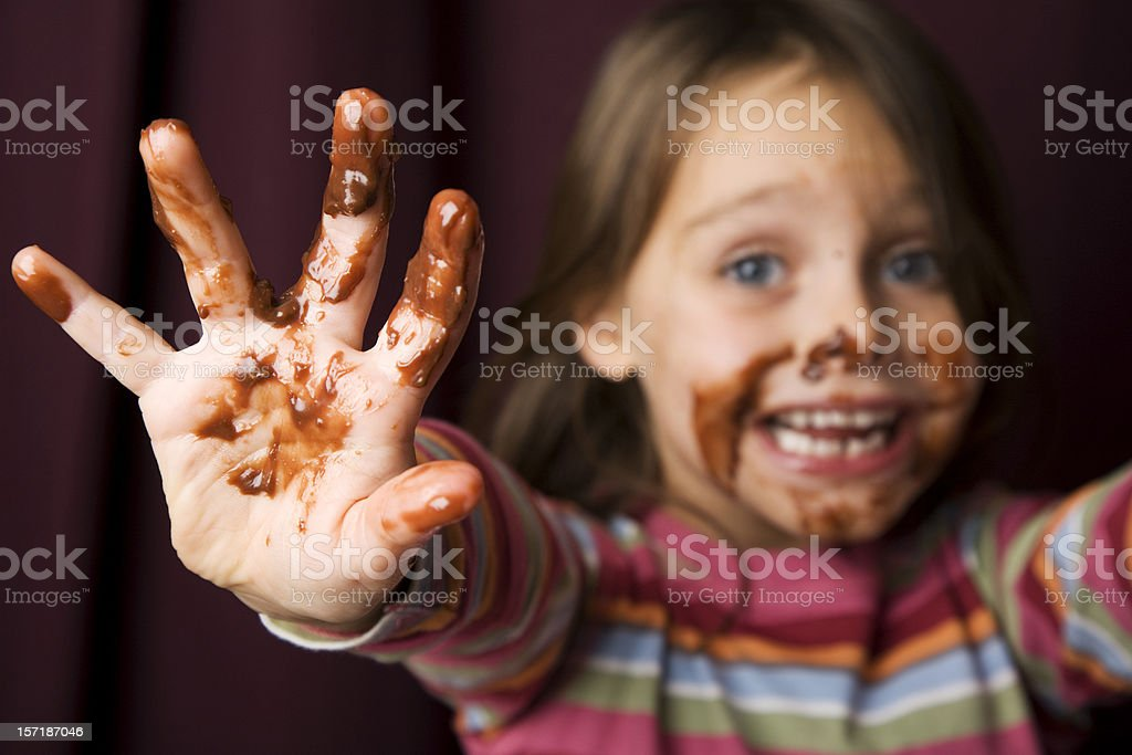 Young Girl Covered in Chocolate. stock photo