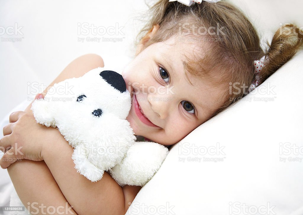 Young girl cuddled up with her teddy royalty-free stock photo