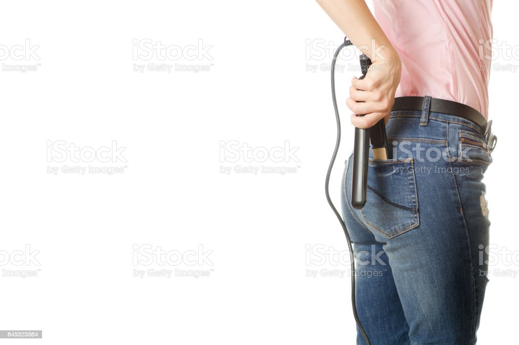 Young girl curling iron for straightening hair stock photo