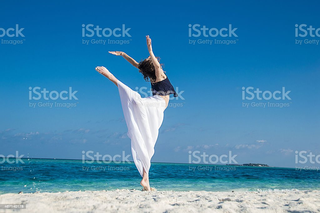 young girl dance at tropical beach, maldives stock photo