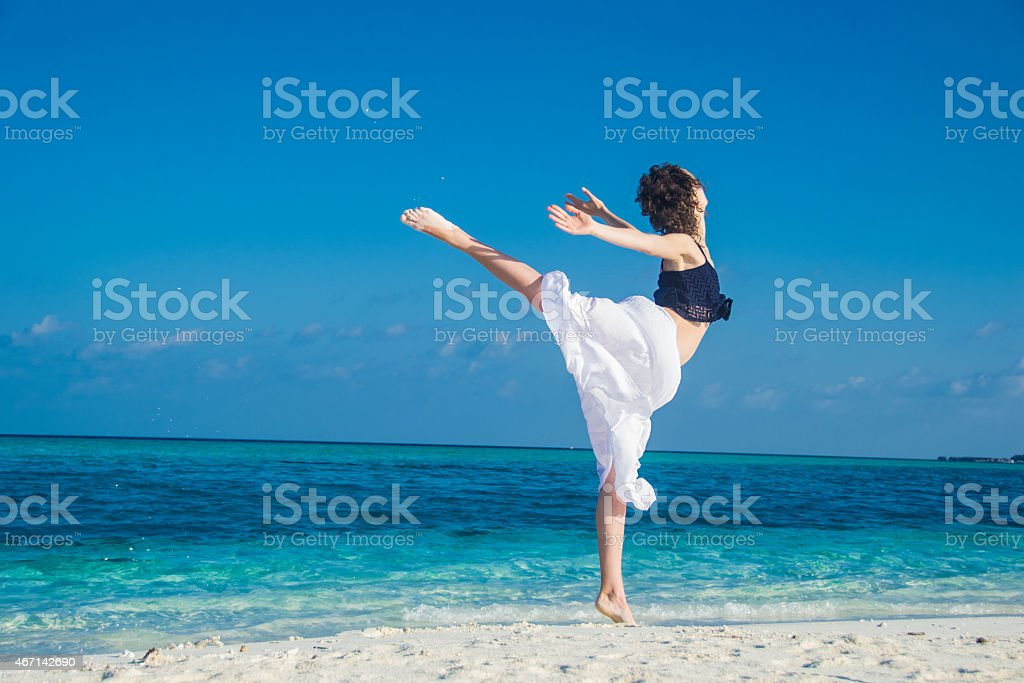 young girl dance at tropical beach stock photo