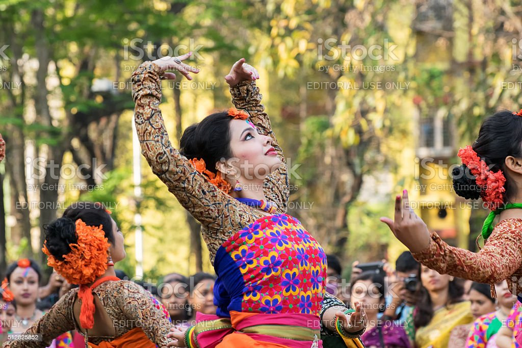 Young girl dancers perforimg at Holi (Spring) festival in Kolkata. stock photo