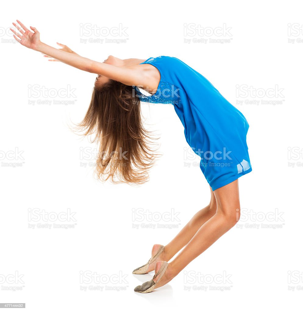 Young girl dancing in a blue dress stock photo