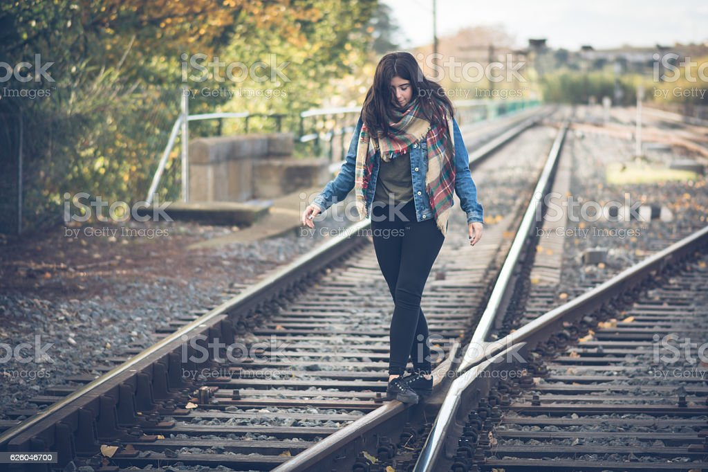 Young Girl dancing in Railroad stock photo