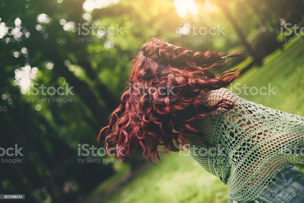Young girl dancing outdoors stock photo