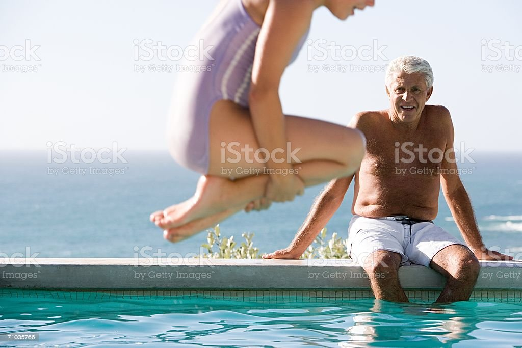 Young girl diving into swimming pool royalty-free stock photo