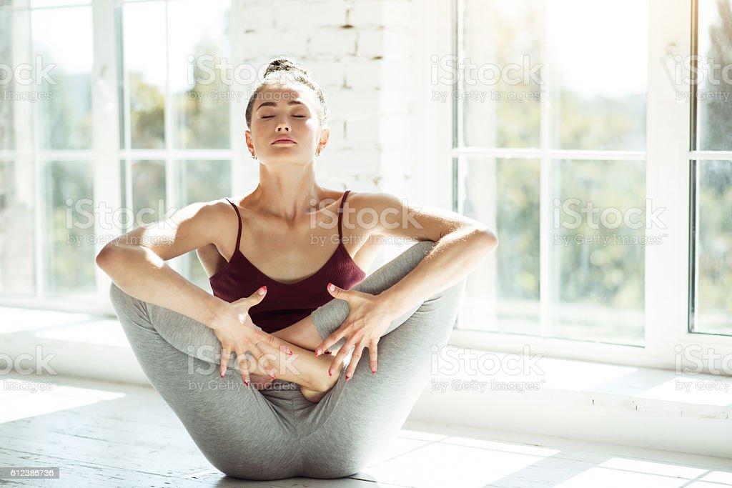 Young girl doing yoga exercises stock photo