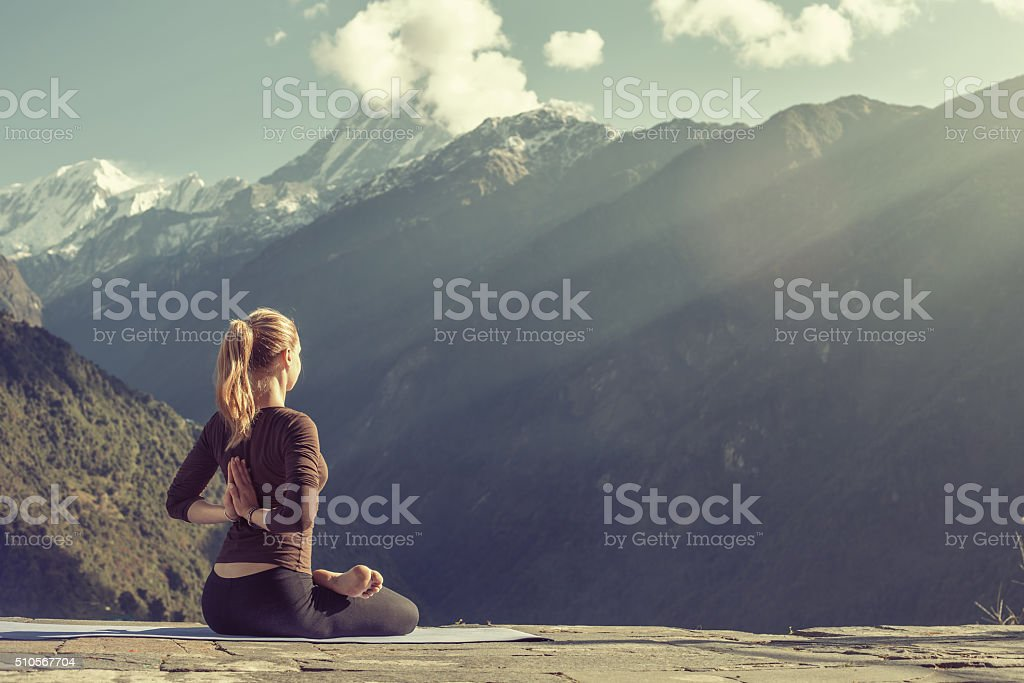 Young girl doing yoga fitness exercise outdoor stock photo