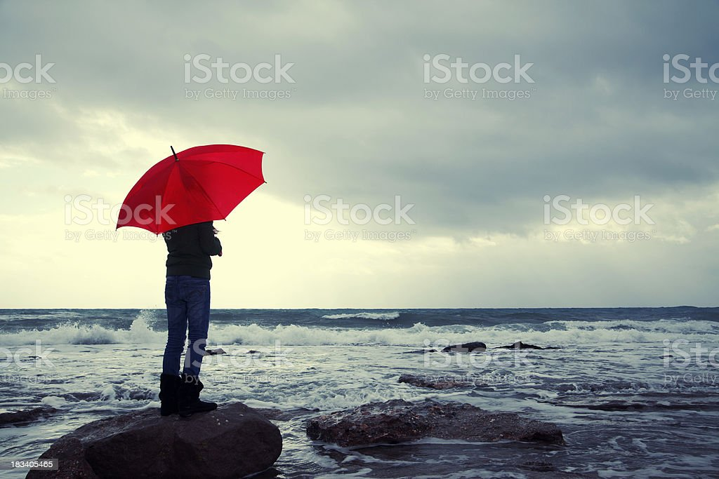 Young girl dreaming at the beach stock photo