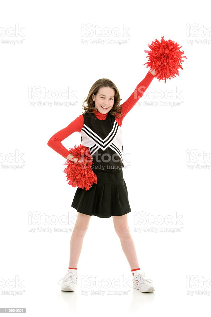 Young girl dressed as cheerleader waving pompoms stock photo