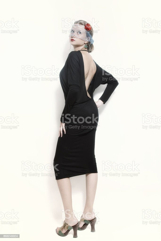 Young girl dressed in black vintage dress stock photo