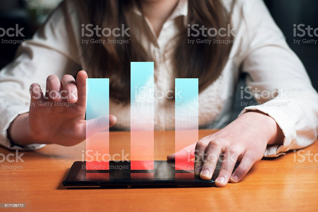 young girl dressed in formal wear, reviews the financial graph stock photo