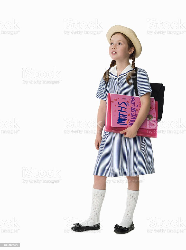 Young girl dressed in uniform holding school work royalty-free stock photo