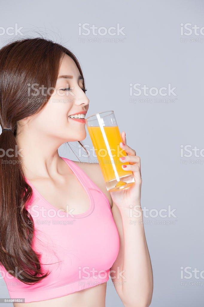 young girl drink orange juice stock photo