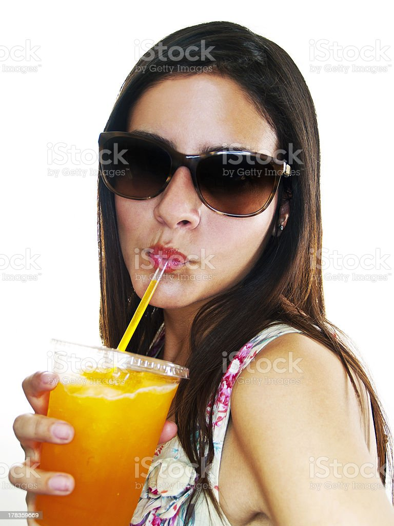 Young Girl Drinking an Orange Frozen Drink stock photo