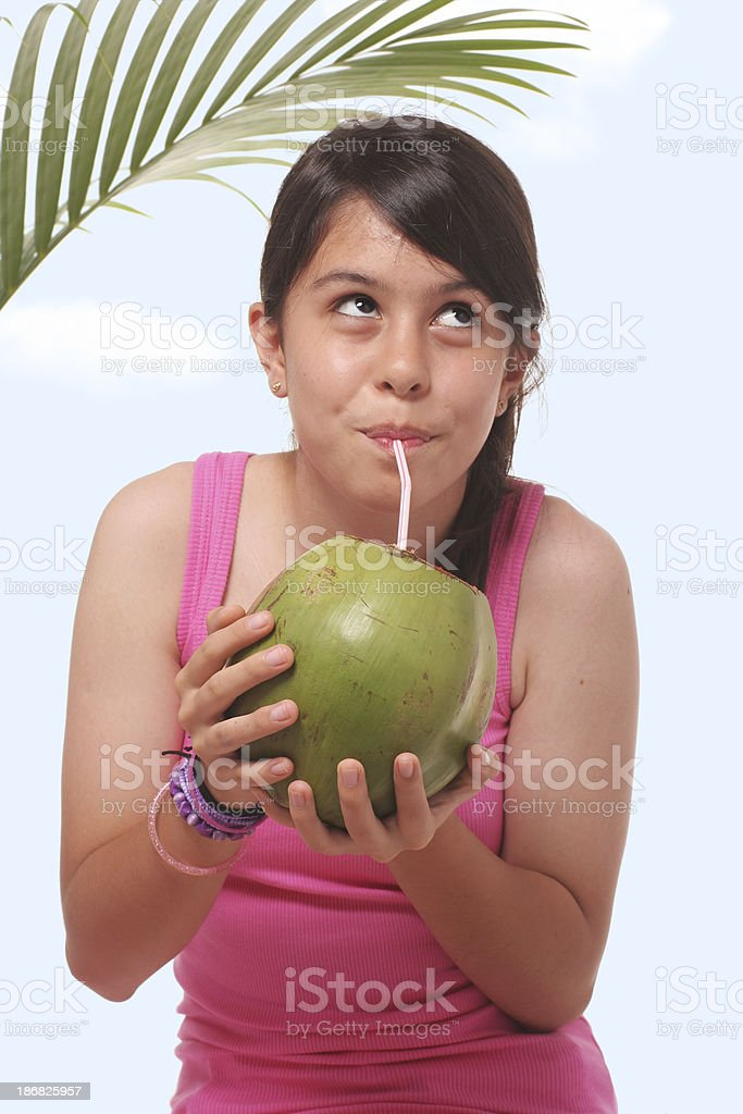 Young Girl Drinking Coconut Milk royalty-free stock photo