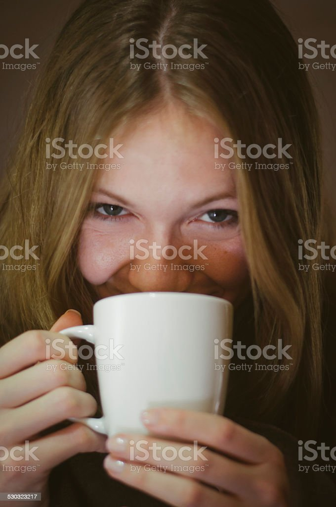Young girl drinking first morning coffee stock photo