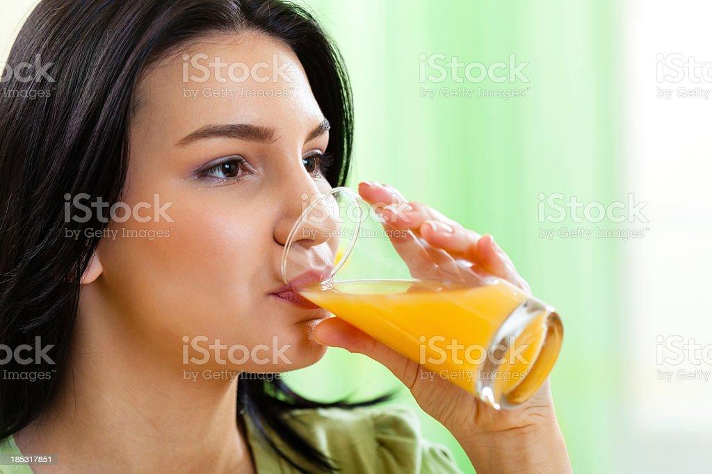 Young girl drinking fresh orange juice royalty-free stock photo