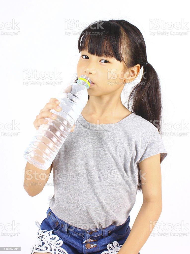 Young girl drinking fresh water from a bottle Lizenzfreies stock-foto