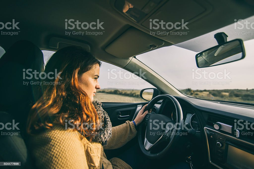 Young girl driving stock photo