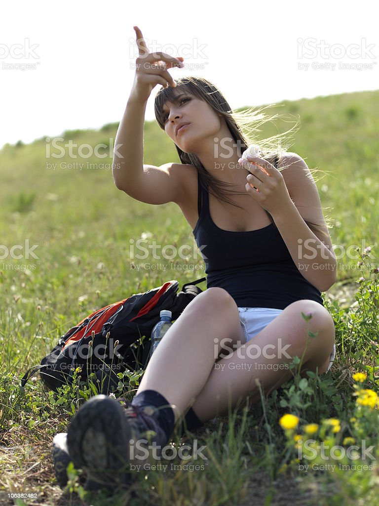 Young girl eating a meal stock photo