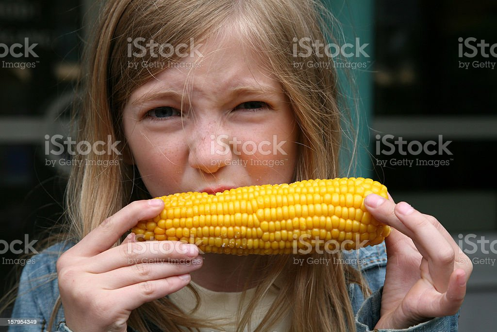 Young Girl Eating Corn royalty-free stock photo