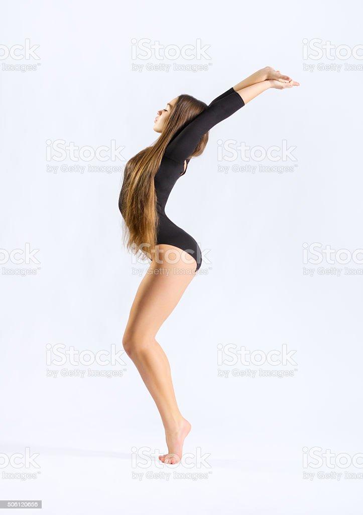 Young girl engaged art gymnastic stock photo