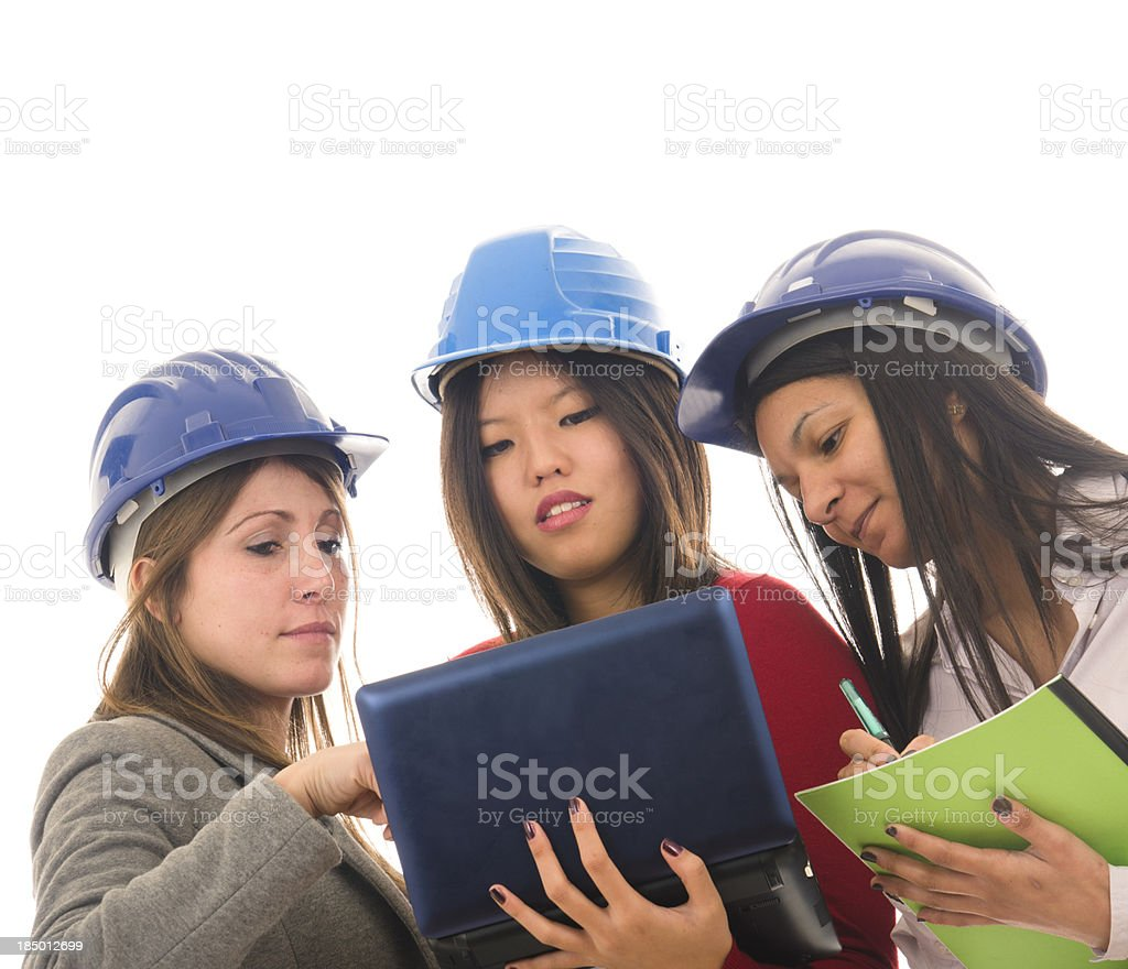 young girl engineer at work with laptop royalty-free stock photo