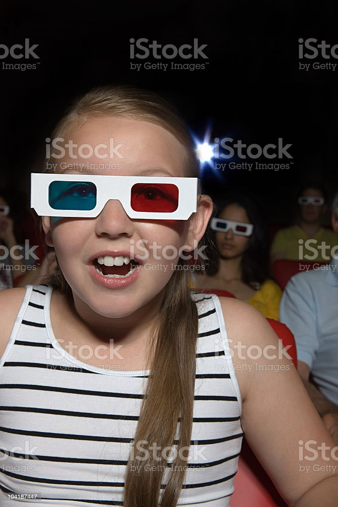 Young girl enjoying a 3d movie royalty-free stock photo