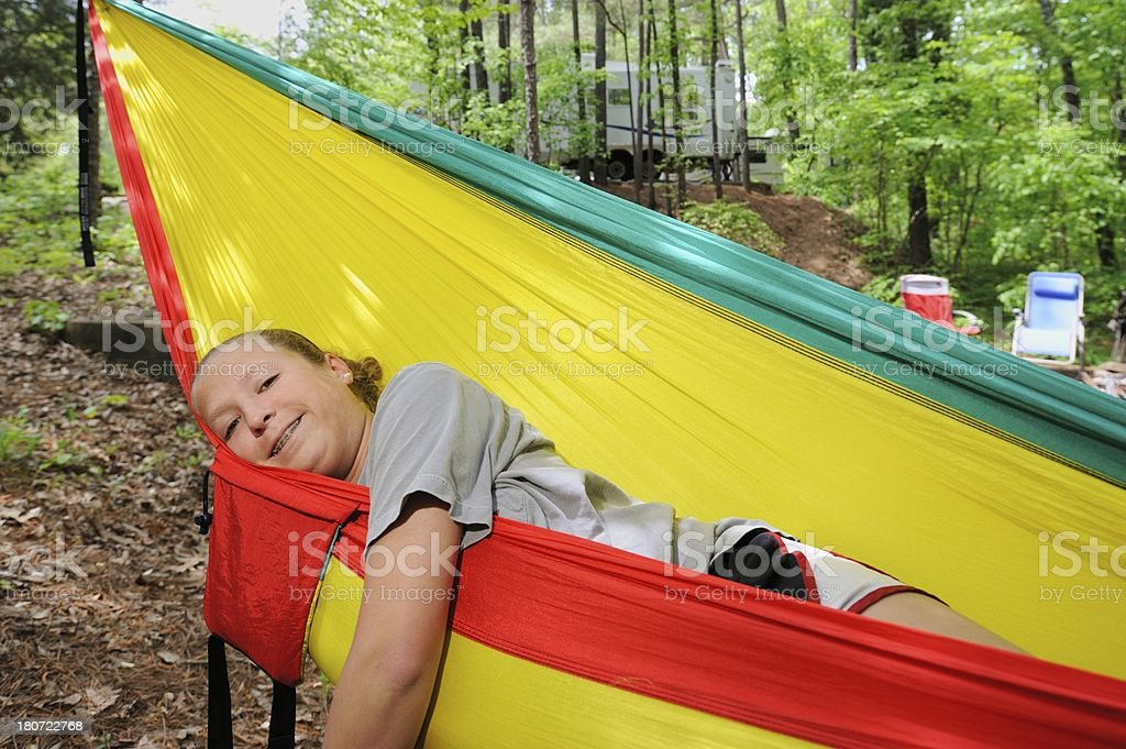Young girl enjoying hammock in campground royalty-free stock photo